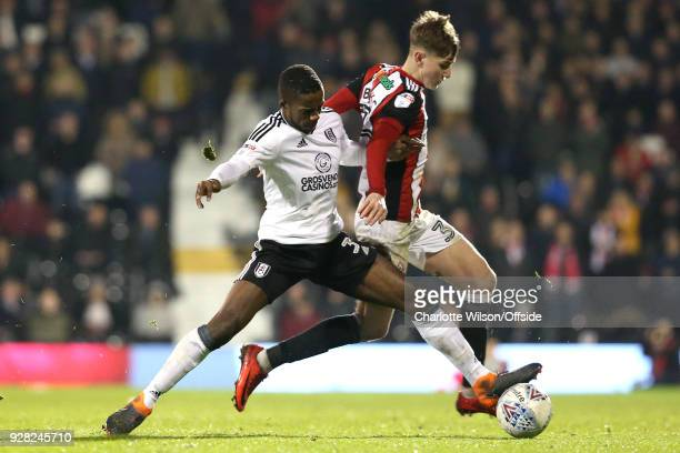 Ryan Sessegnon of Fulham stretches to tackle David Brooks of Sheffield United during the Sky Bet Championship match between Fulham and Sheffield...