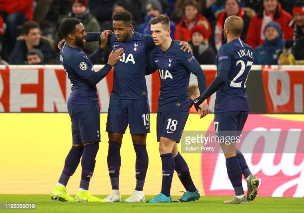 Ryan Sessegnon of Tottenham Hotspur celebrates with teammates after scoring his team's first goal during the UEFA Champions League group B match...