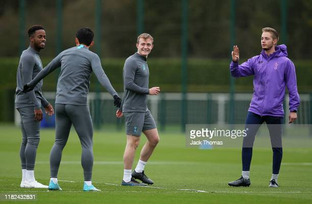 Ryan Sessegnon Son Heungmin and Oliver Skipp of Tottenham Hotspur participate in a training session ahead of the UEFA Champions League group B match...
