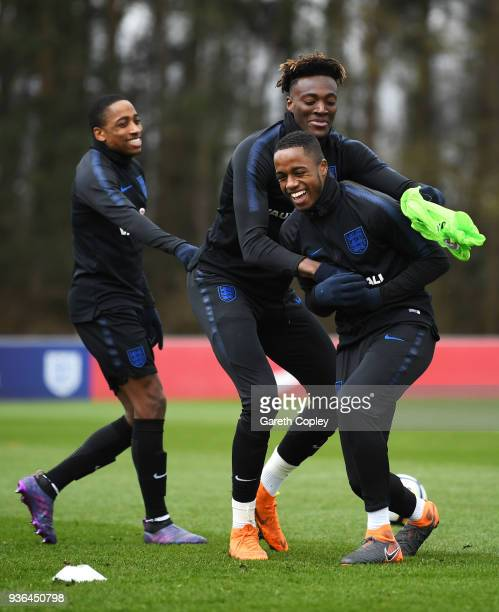Ryan Sessegnon Tammy Abraham and Kyle WalkerPeters joke during an England U21 training session at St Georges Park on March 22 2018 in BurtonuponTrent...