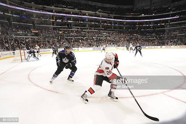 Ryan Shannon of the Ottawa Senators passes the puck as Jack Johnson of the Los Angeles Kings defends during the game on December 3, 2009 at Staples...