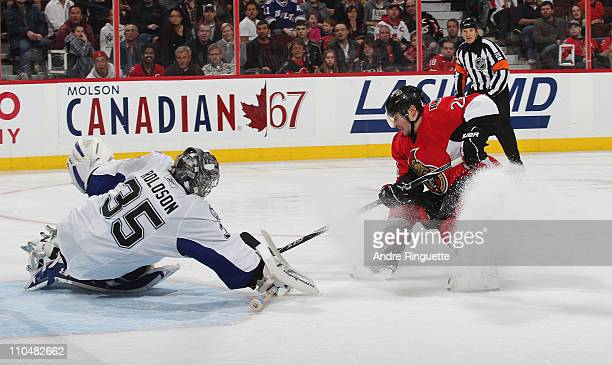 Ryan Shannon of the Ottawa Senators scores the tying goal of the game against Dwayne Roloson of the Tampa Bay Lightning at Scotiabank Place on March...
