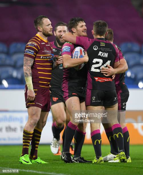 Ryan Shaw of Hull KR celebrates with teammates after scoring a second half try during the Betfred Super League match between Huddersfield Giants and...
