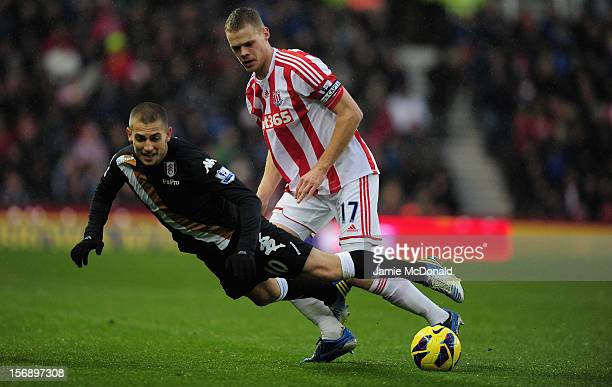 Ryan Shawcross of Soke City battles with Mladen Petric of Fulham during the Barclays Premier League match between Stoke City and Fulham at the...
