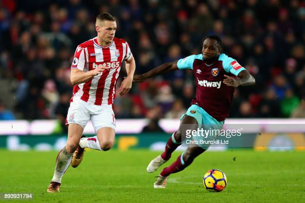 Ryan Shawcross of Stoke City and Diafra Sakho of West Ham United in action during the Premier League match between Stoke City and West Ham United at...