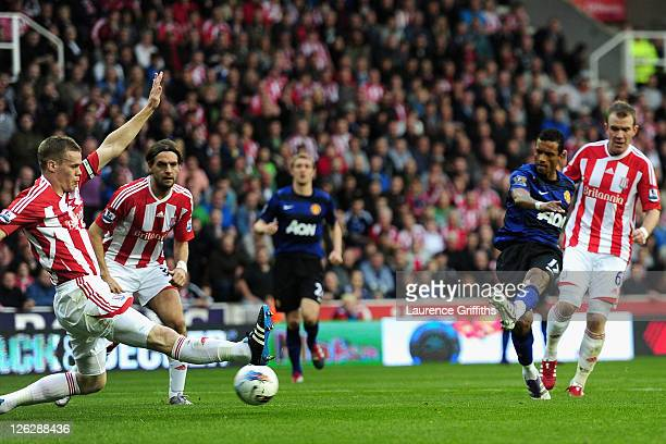 Ryan Shawcross of Stoke City attempts to block the goal scored by Nani of Manchester United during the Barclays Premier League match between Stoke...
