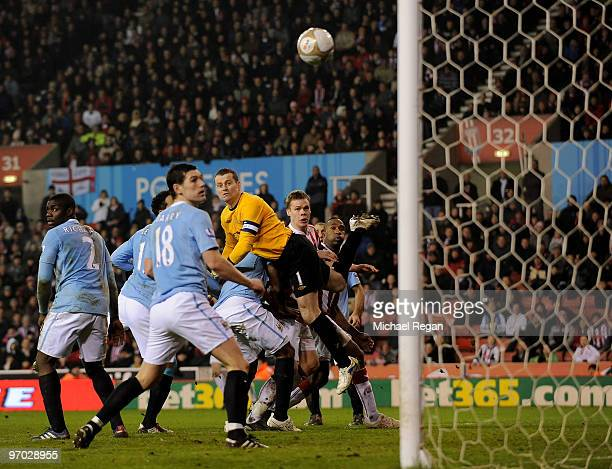 Ryan Shawcross of Stoke City beats Shay Given of Manchester City to the ball to score the 2nd Stoke goal during the FA Cup 5th round match between...