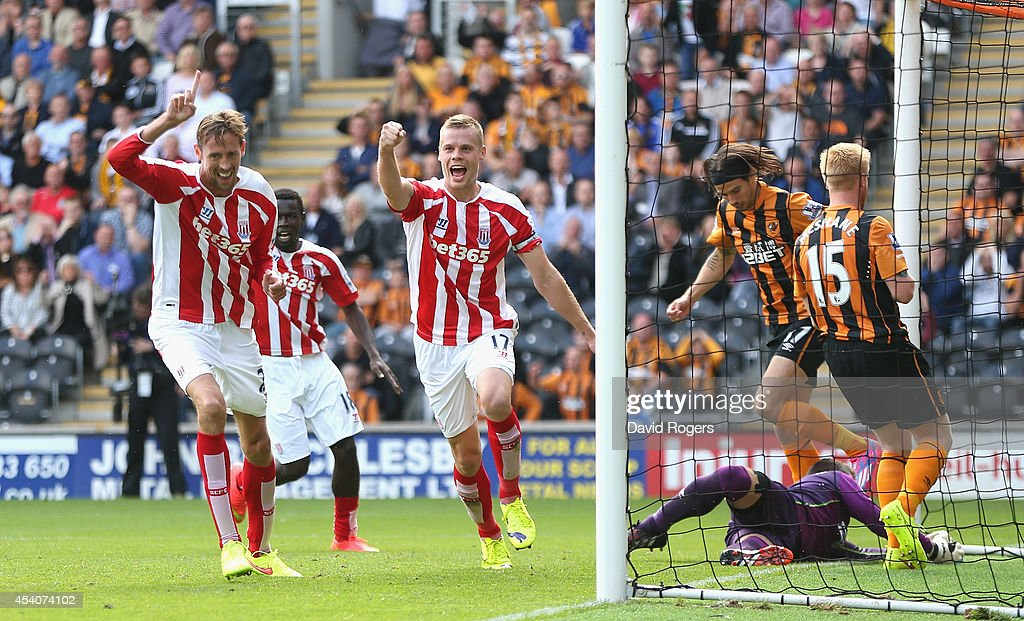 Ryan Shawcross (R) of Stoke City celebrates with team mate Peter Crouch after scoring the equalising goal during the Barclays Premier League match between Hull City and Stoke City at the KC Stadium on August 24, 2014 in Hull, England.