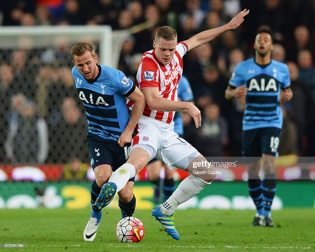 Ryan Shawcross of Stoke City challenges Harry Kane of Tottenham Hotspur during the Barclays Premier League match between Stoke City and Tottenham Hotspur at the Britannia Stadium on April 18, 2016 in Stoke on Trent, England.