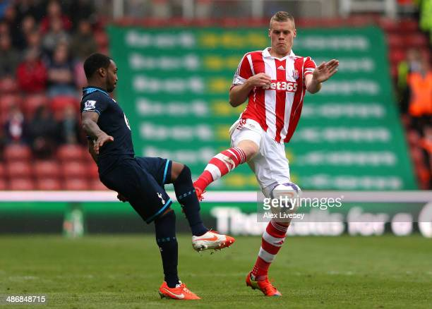 Ryan Shawcross of Stoke City fouls Danny Rose of Tottenham Hotspur and is sent off after receiving a second yellow card during the Barclays Premier...
