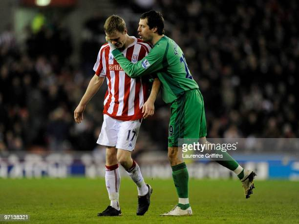 Ryan Shawcross of Stoke City is consoled by team mate Thomas Sorensen as he leaves the pitch in tears after being sent off for a challenge on Aaron...