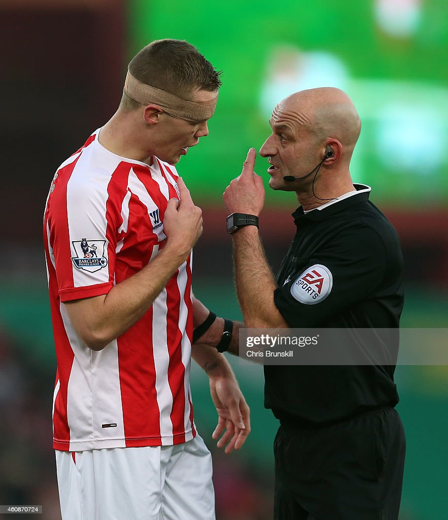 Ryan Shawcross of Stoke City is spoken to by referee Roger East during the Barclays Premier League match between Stoke City and West Bromwich Albion on December 28, 2014 in Stoke on Trent, England.