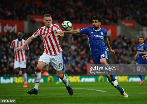 Ryan Shawcross of Stoke City is tackled by Diego Costa of Chelsea during the Premier League match between Stoke City and Chelsea at Bet365 Stadium on...