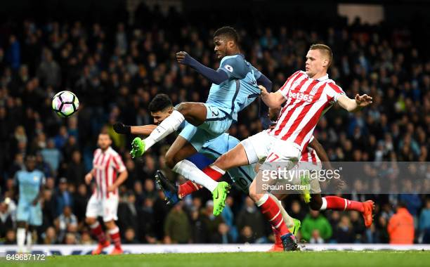 Ryan Shawcross of Stoke City pulls back Kelechi Iheanacho of Manchester City during the Premier League match between Manchester City and Stoke City...