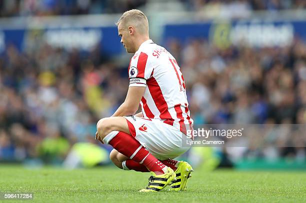 Ryan Shawcross of Stoke City shows his captains armband during the Premier League match between Everton and Stoke City at Goodison Park on August 27...