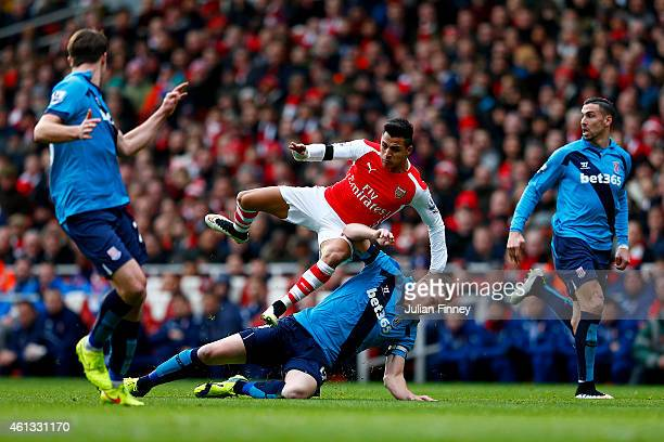 Ryan Shawcross of Stoke City slides in on Alexis Sanchez of Arsenal during the Barclays Premier League match between Arsenal and Stoke City at...