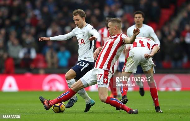 Ryan Shawcross of Stoke City tackles Christian Eriksen of Tottenham Hotspur during the Premier League match between Tottenham Hotspur and Stoke City...