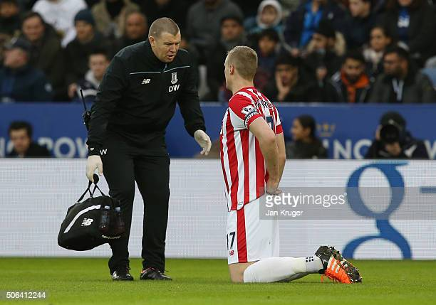 Ryan Shawcross of Stoke City talks with a medical staff during the Barclays Premier League match between Leicester City and Stoke City at The King...