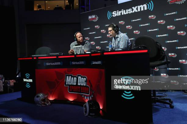 Ryan Shazier and Adam Schein attend SiriusXM at Super Bowl LIII Radio Row on February 01 2019 in Atlanta Georgia