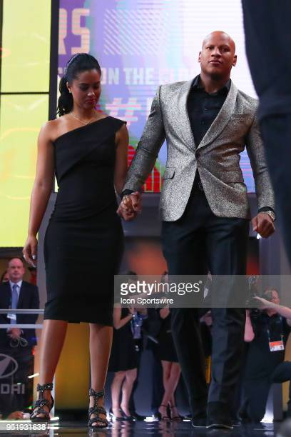 Ryan Shazier flanked by his Fiancee Michelle Rodriguez walks onto the stage for the Pittsburgh Steelers 28th pick during the first round at the 2018...
