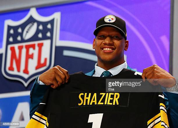 Ryan Shazier of the Ohio State Buckeyes poses with a jersey after he was picked overall by the Pittsburgh Steelers during the first round of the 2014...
