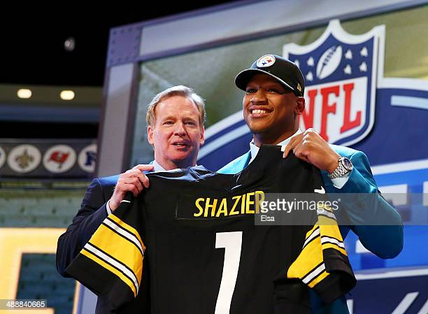 Ryan Shazier of the Ohio State Buckeyes poses with NFL Commissioner Roger Goodell after he was picked overall by the Pittsburgh Steelers during the...