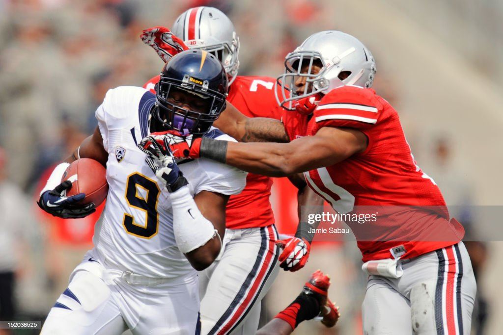 Ryan Shazier #10 of the Ohio State Buckeyes reaches to haul down C.J. Anderson #9 of the California Golden Bears after a large gain at Ohio Stadium on September 15, 2012 in Columbus, Ohio. Ohio State defeated California 35-28.