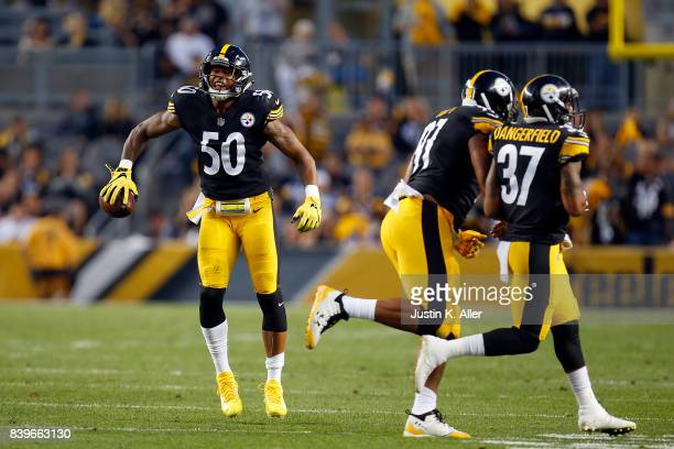 Ryan Shazier of the Pittsburgh Steelers celebrates after intercepting a pass in the first half against the Indianapolis Colts during a preseason game...