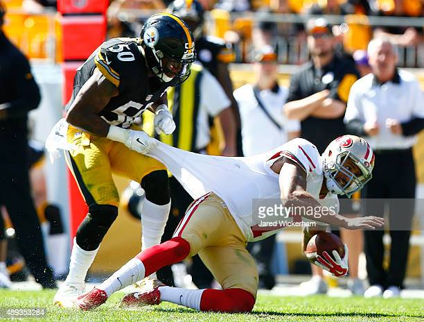 Ryan Shazier of the Pittsburgh Steelers tackles Colin Kaepernick of the San Francisco 49ers by grabbing his jersey in the third quarter during the...