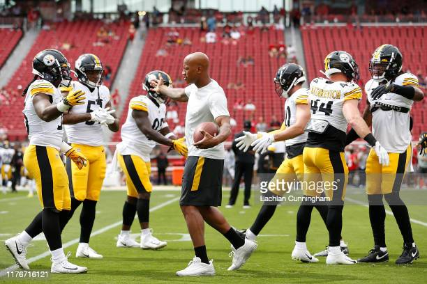 Ryan Shazier of the Pittsburgh Steelers with teammates before the game against the San Francisco 49ers at Levi's Stadium on September 22, 2019 in...