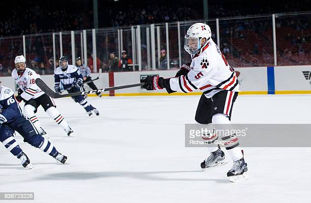 """Ryan Shea of the Northeastern Huskies skates against the New Hampshire Wildcats during NCAA hockey at Fenway Park during """"Frozen Fenway"""" on January..."""
