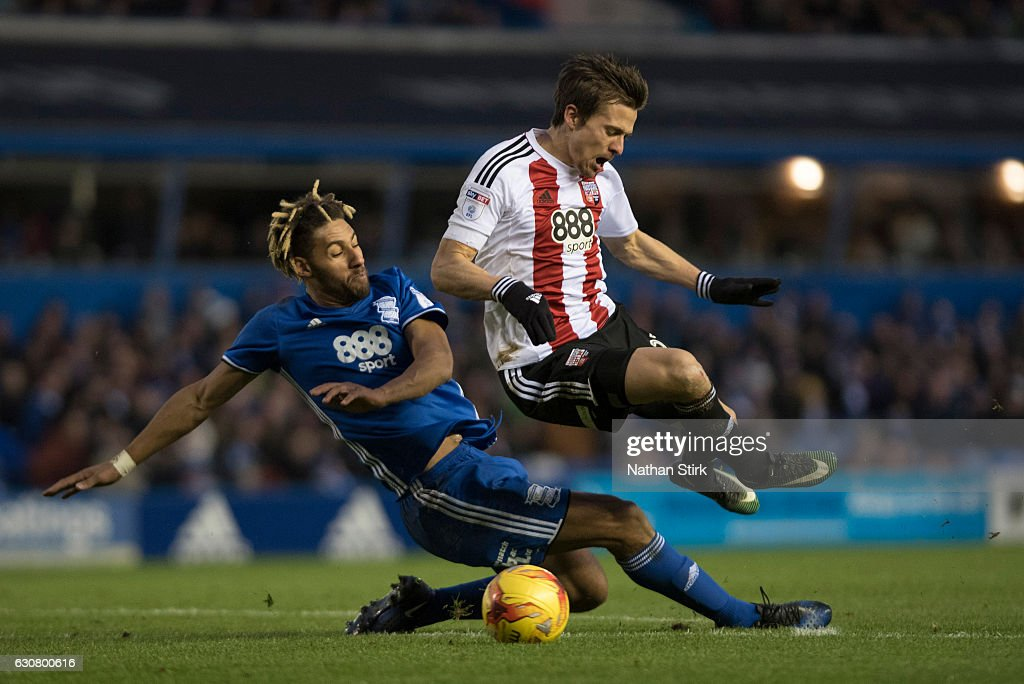 Ryan Shotton of Birmingham City gives away a penalty after tackling Lasse Vibe of Brentford during the Sky Bet Championship match between Birmingham City and Brentford at St Andrews Stadium on January 2, 2017 in Birmingham, England (Photo by Nathan Stirk/Getty Images).