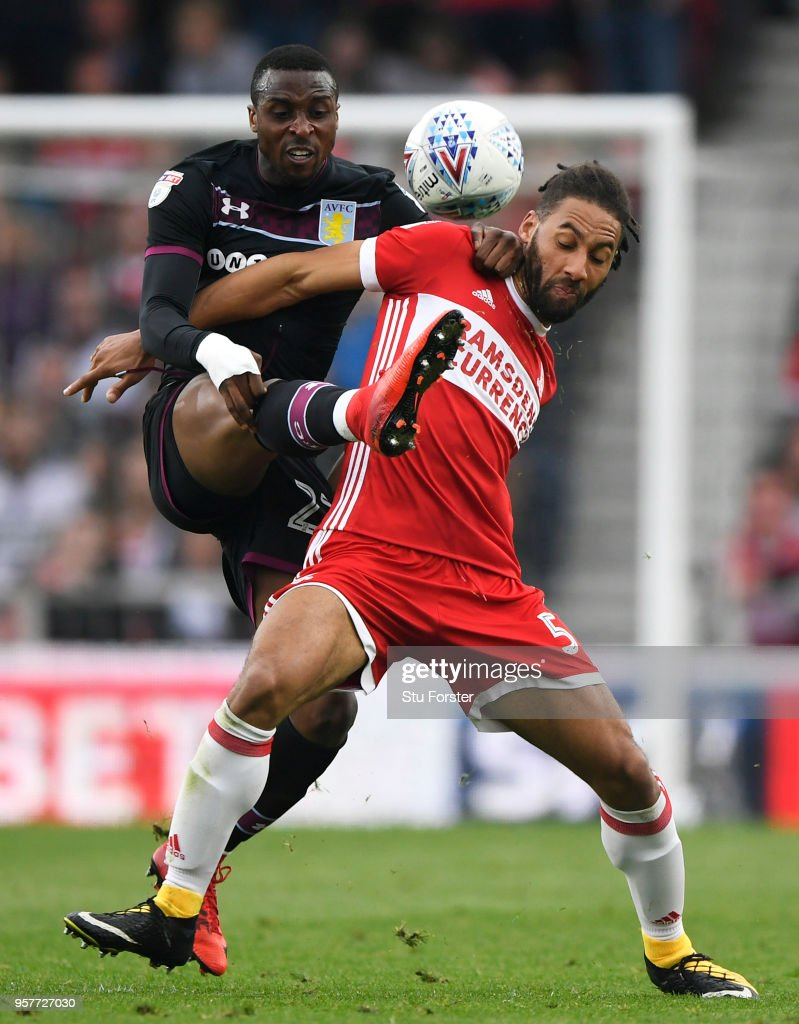 Ryan Shotton of Middlesborough is challenged by Jonathan Kodija of Aston Villa during the Sky Bet Championship Play Off Semi Final:First Leg match between Middlesbrough and Aston Villa at Riverside Stadium on May 12, 2018 in Middlesbrough, England.