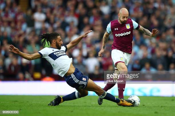 Ryan Shotton of Middlesbrough battles for possession with Alan Hutton of Aston Villa during the Sky Bet Championship Play Off Semi Final second leg...