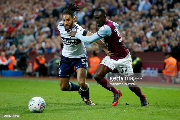 Ryan Shotton of Middlesbrough competes with Albert Adomah of Aston Villa during the Sky Bet Championship Play Off Semi FinalSecond Leg match between...