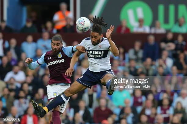 Ryan Shotton of Middlesbrough heads towards goal under pressure from Lewis Grabban of Aston Villa during the Sky Bet Championship Play Off Semi...
