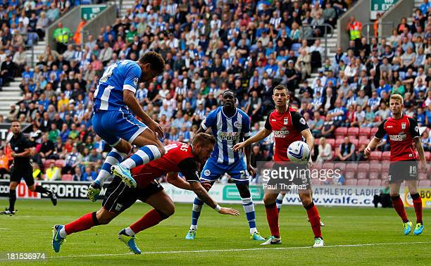 Ryan Shotton of Wigan scores the opening goal during the Sky Bet Championship match between Wigan Athletic and Ipswich Town at the DW Stadium on...