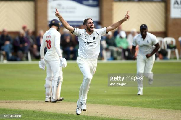 Ryan Sidebottom of Warwickshire celebrates the wicket of Jack Murphy of Glamorgan during day 1 of the Specsavers County Championship: Division Two...
