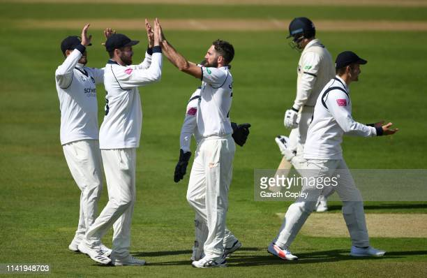 Ryan Sidebottom of Warwickshire celebrates with teammates after dismissing Sean Dickson of Kent during the Specsavers County Championship Division...