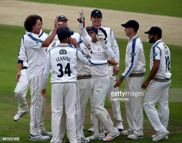 Ryan Sidebottom of Yorkshire celebrates taking the wicket of Alex Davies of Lancashire with teamates during Day One of the Specsavers County...