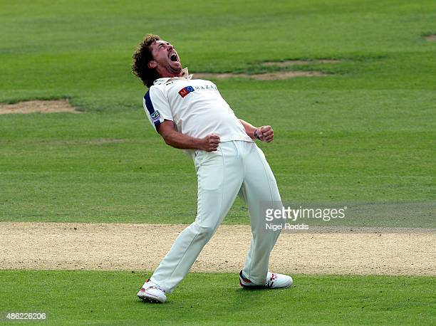 Ryan Sidebottom of Yorkshire celebrates taking the wicket of Marcus Trescothick of Somerset during the LV County Championship match between Yorkshire...
