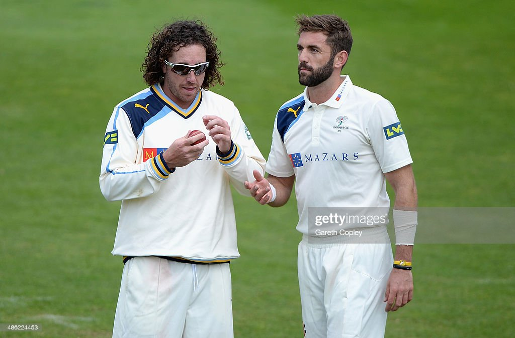 Ryan Sidebottom of Yorkshire speaks with Liam Plunkett during day four of the LV County Championship division One match between Yorkshire and Northamptonshire at Headingley on April 23, 2014 in Leeds, England.