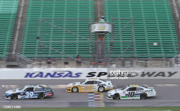 Ryan Sieg, driver of the CMRRoofing.com Chevrolet, Austin Cindric, driver of the XPEL Ford, and Ross Chastain, driver of the Dyna-Gro Seed Chevrolet,...