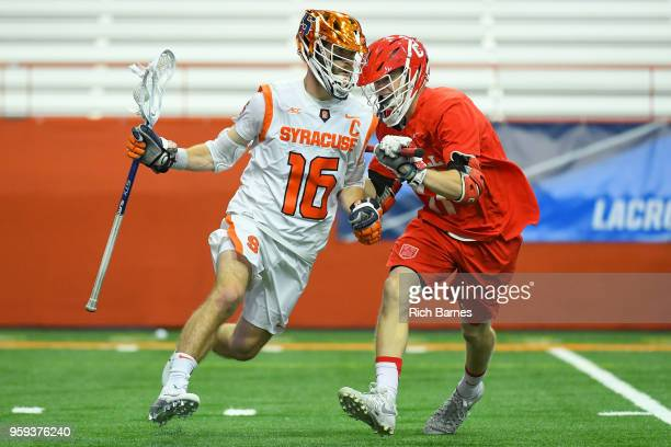 Ryan Simmons of the Syracuse Orange controls the ball against the defense of Harrison Bardwell of the Cornell Big Red during a 2018 NCAA Division I...