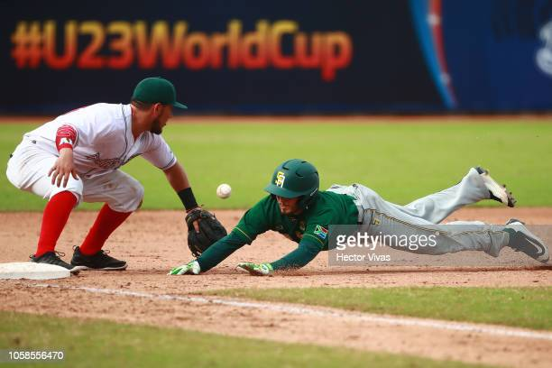 Ryan Simon of South Africa slides against Javier Erro of Mexico in the 3th inning during a match between South Africa and Mexico as part of WBSC U23...