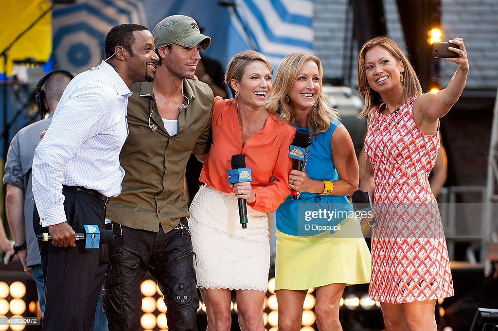 Ryan Smith, Enrique Iglesias, Amy Robach, Lara Spencer, and Ginger Zee pose for a picture on stage during ABC's 'Good Morning America' at Rumsey Playfield, Central Park on August 1, 2014 in New York City.