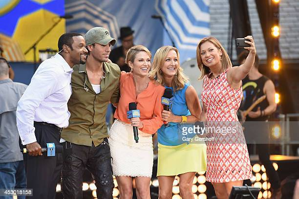 Ryan Smith Enrique Iglesias Lara Spencer Amy Robach and Ginger Zee take an 'ussie' on stage at ABC's 'Good Morning America' at Rumsey Playfield...