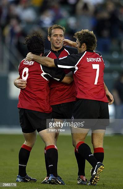 Ryan Smith of Canada celebrates defeating Australia 2612 with teammates Derek Daypuck and Matt Cohen after game 14 of the IRB Rugby USA Seven Series...