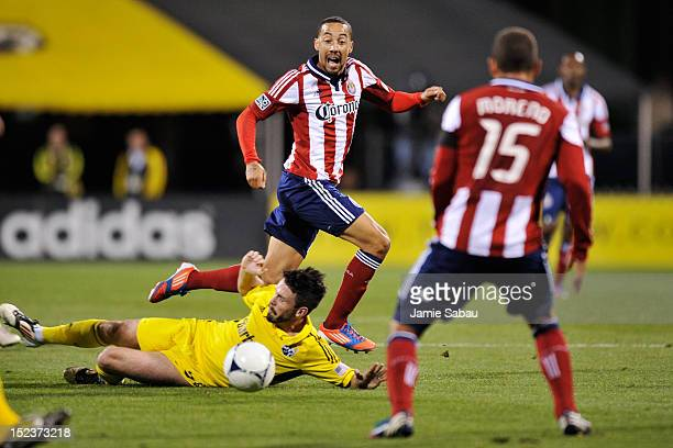 Ryan Smith of Chivas USA passes the ball to teammate Alejandro Moreno of Chivas USA as Danny O'Rourke of the Columbus Crew attempts to defend in the...