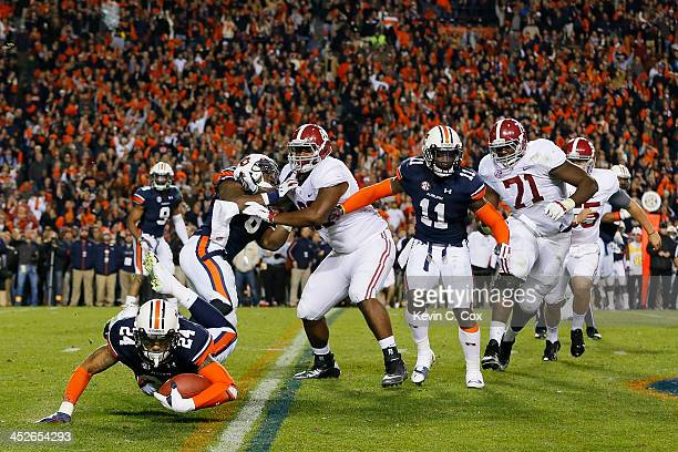 Ryan Smith of the Auburn Tigers recovers a blocked field goal in the fourth quarter against the Alabama Crimson Tide at JordanHare Stadium on...